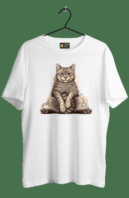 Коте Сидить